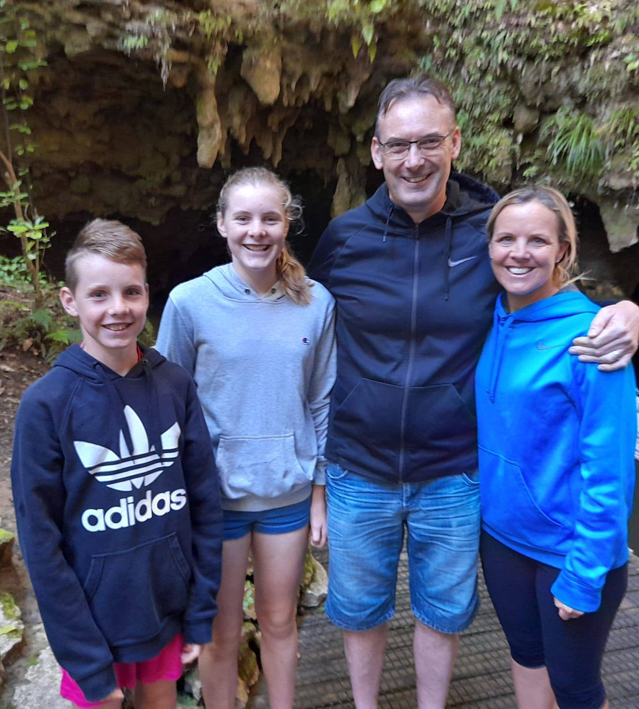The McGraths in a cave in New Zealand, L to R Finn, Mia, Gerard, Juliet (they don't live in the cave)