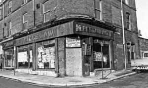 The end of The Rickshaw, closed and boarded up.