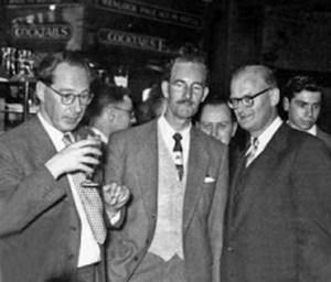 John Wyndham, Ted Carnell and Arthur C. Clarke.
